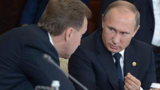 Russian President Vladimir Putin speaks with Russian First Deputy Prime Minister Igor Shuvalov during an expanded meeting of the CIS (Commonwealth of Independent States) Council of Heads of State in the village of Burabai, Kazakhstan.
