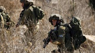 Israeli soldiers patrol near border with Lebanon