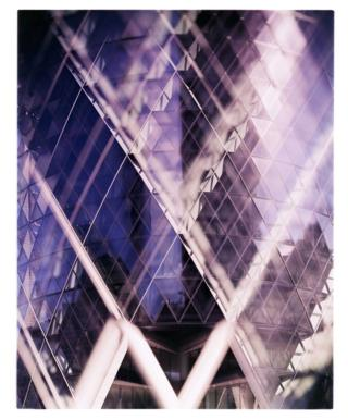 A close-up of the glass of the Gherkin