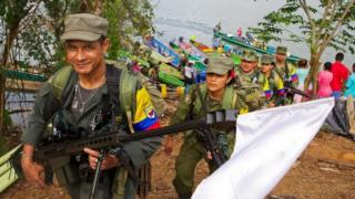 FARC guerrillas disembark to hand on their weapons in the remote area of Gallo, Cordoba department, Colombia on February 2, 2017