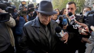 Ion Ficior surrounded by journalists after he was charged in 2013 (file picture)