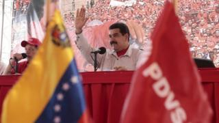 Venezuela's President Nicolas Maduro waves to supporters on 1 August, 2015