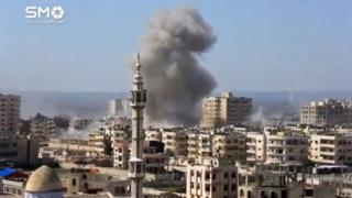 A still image taken from a video uploaded to a social media website on 25 February 2017, purportedly showing air strikes on rebel-held Homs district of al-Wair
