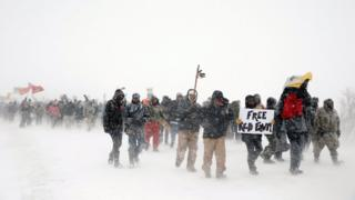 Veterans join activists in a march just outside the Oceti Sakowin camp