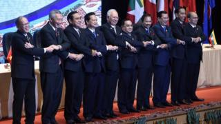 Asean leaders link arms for a group photo