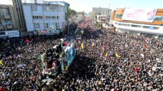 Large crowds in the Iranian town of Kerman for the funeral of late military commander Qasem Soleimani