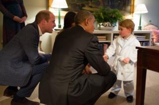 Prince George meeting the President of the United States Barack Obama and First Lady Michelle Obama at Kensington Palace, London