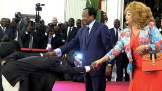 "This video grab image created on February 8, 2017 shows Cameroonian national football team players perform a ""deep bow"" to President Paul Biya (L) and his wife Chantal Biya in Yaounde, following their 2-1 victory over Egypt in the finals of the 2017 Africa Cup of Nations in Libreville, Gabon."