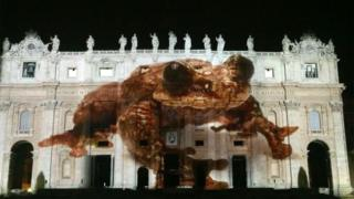 """An image of """"Toughie"""" projected onto St Peter's Basilica"""