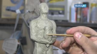 A sculptor works on the planned award for Leonardo DiCaprio