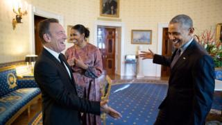 The president reaches out to shake hands with Bruce Springsteen in the Blue Room of the White House prior to the Presidential Medal of Freedom ceremony
