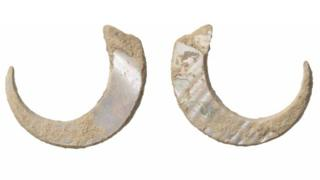 A pair of ancient fish hooks found in a cave in Japan
