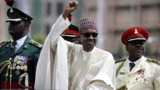 In this 29 May 2015 photo, Nigerian President, Muhammadu Buhari, salutes his supporters during his inauguration in Abuja, Nigeria