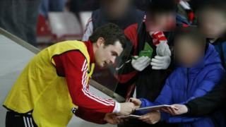 Adam Johnson signs autographs for fans