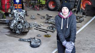 Daniel Kristensen poses with debris from the wreck of a World War II aircraft, which he and his father found yesterday near Birkelse by Aabybro in Northern Jutland