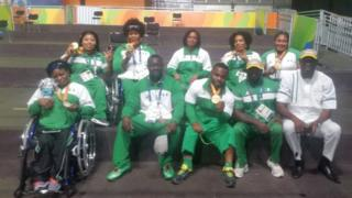 the nigerian powerlifting team with coach