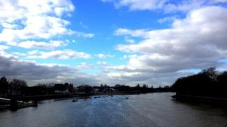 A view of the Thames river. Blue sky and cloud above.