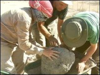 Lee Jones, Daniel Jones and Tim Lewis remove raw clay cooking pot for environmental sampling and conservation