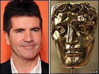 Simon Cowell with Bafta mask