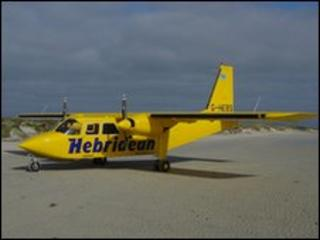 A Hebridean Airways plane on a beach