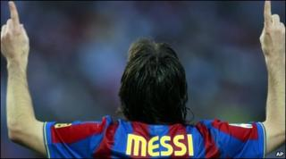 Lionel Messi celebrates after scoring against Valladolid during a Spanish La Liga soccer match at the Camp Nou stadium in Barcelona on 16 May