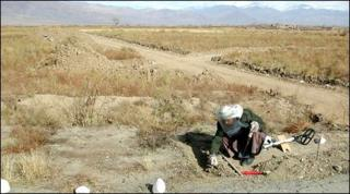 A man removing mines from the war zone in Afghanistan