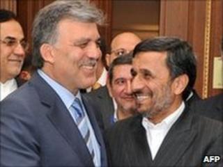 Iranian President Mahmoud Ahmadinejad (R) shakes hands with Turkish President Abdullah Gul in Istanbul on 7 June 2010
