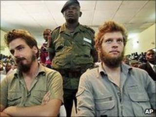 Norwegian citizens Tjostolv Moland, left, and Joshua French, right, listen to a judge reading out their sentence in Kisangani, DR Congo, on 8 September 2009