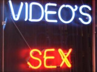 Neon sign outside sex shop, BBC
