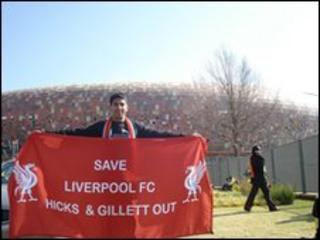 Ziyaad Hassam outside Soccer City Stadium in Johannesburg with one of the banners