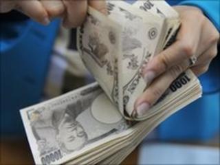 A woman counts Japanese Yen (file photo)