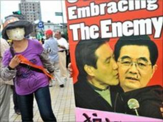 Placard of Taiwan's President Ma Ying-jeou and Chinese President Hu Jintao during a protest in Taipei on 26 June