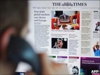 A man looks at the Times newspaper's website on a computer screen