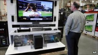 Man watching TV in California shop - file photo
