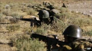 Afghan National Army soldiers participate in exercises with Nato forces outside Herat, Afghanistan
