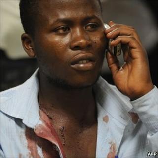 Someone injured during grenade attacks at a prayer meeting organised by referendum campaigners on 13 June 2010 speaks speaks on phone at the Kenyatta National Hospital in Nairobi