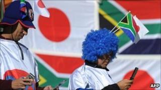 Japan football fans on phones