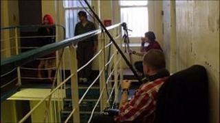 Cast and crew filming in the prison