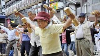 Ageing Tokyo residents use dumbbells on Respect for the Aged Day