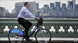 Man rides one of the cycles for hire