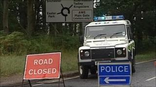 police car at road closure