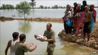 Soldiers help rescue people in Nowshera stranded by flood water in Pakistan