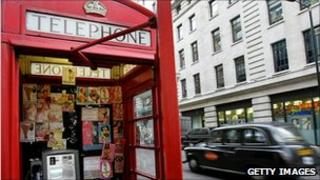 Prostitute calling cards in a London telephone box