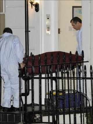 The body being removed from the flat