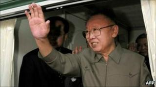 Kim Jong-il waves from a train leaving Beijing on 7 May 2010