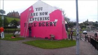 Free Derry Corner being painted pink.