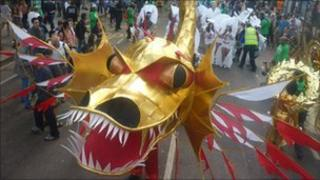 Golden dragon costume on Ladbroke Grove