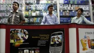 Indian salesmen at a mobile store in Hyderabad, India