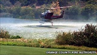 An Orange COunty helicopter battles the blaze