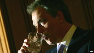 Tony Blair sipping from a tumbler